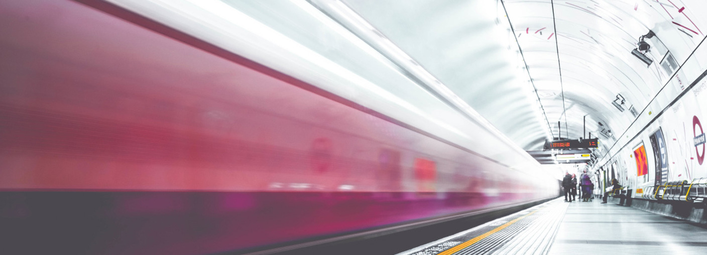 Image of train speeding by depicting advances in transit technology